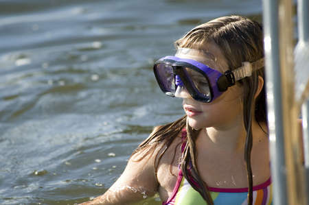Teenage girl with swim goggles, Lake of the Woods, Ontario, Canada