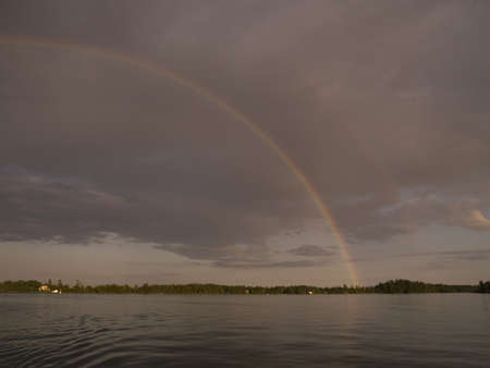 Rainbow over lake shoreline, Lake of the Woods, Ontario, Canada Stock Photo - 7191471