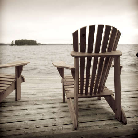 adirondack chair: Adirondack chairs on deck, Muskoka, Ontario, Canada