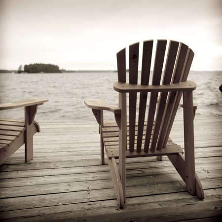 Adirondack chairs on deck, Muskoka, Ontario, Canada