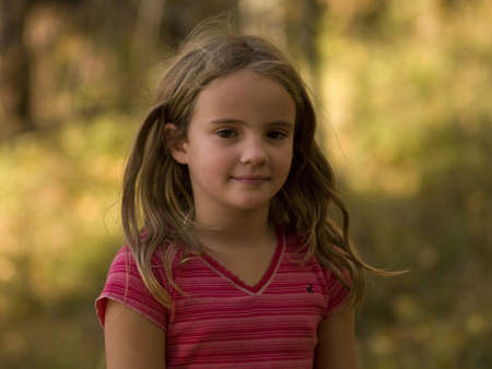 preadolescent: Portrait of young girl outdoors, Lake of the Woods, Ontario, Canada Stock Photo