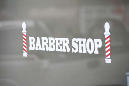 Barber shop sign, Bracebridge, Ontario, Canada; Sign for a barber shop photo