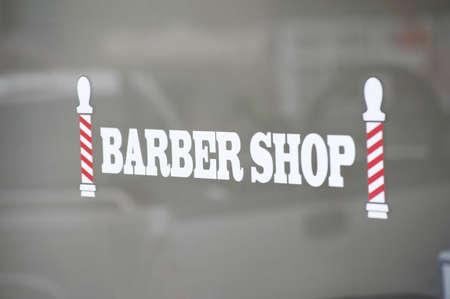 Barber shop sign, Bracebridge, Ontario, Canada; Sign for a barber shop Stock Photo