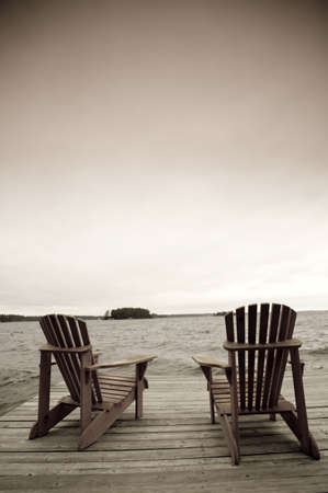 pier: Adirondack chairs on deck, Muskoka, Ontario, Canada