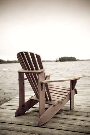 lake fronts: Adirondack chair on deck, Muskoka, Ontario, Canada