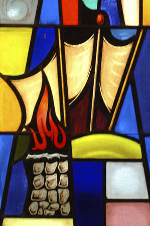 stained glass windows: Mosaic with altar and flame Stock Photo