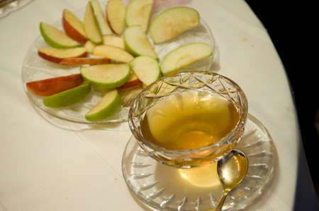 Apple slices and bowl of honey photo