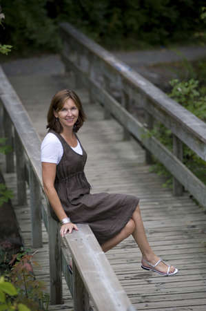Woman on bridge, Bracebridge, Ontario, Canada photo