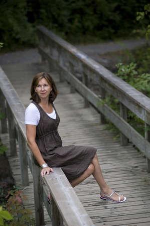 Woman on bridge, Bracebridge, Ontario, Canada