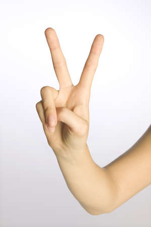 twentysomething: Womans hand making a peace sign