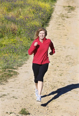 50 something fifty something: Woman running