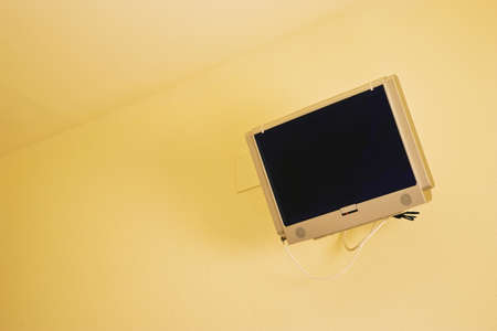 Flat screen TV on a wall   Banco de Imagens