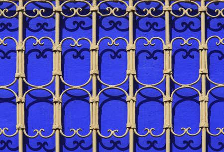 Iron railings against blue walls, Majorelle Gardens, Marrakech, Morocco