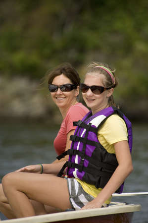 Women in boat, Lake of the Woods, Ontario, Canada photo