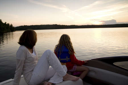 Enjoying sunset from boat, Lake of the Woods, Ontario, Canada photo