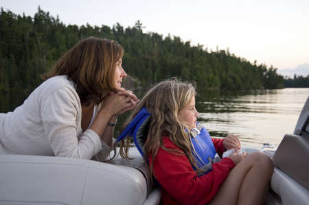 lifevest: Mother and daughter boating, Lake of the Woods, Ontario, Canada Stock Photo