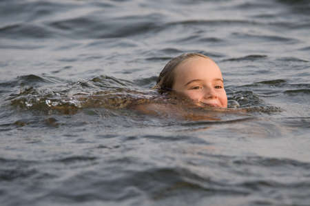 caucasian ancestry: Young girl swimming in lake, Lake of the Woods, Ontario, Canada Stock Photo