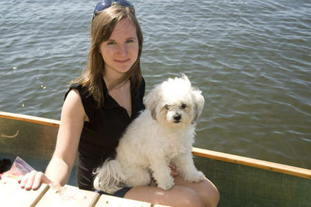 pre adolescence: Girl in boat with dog, Lake of the Woods, Ontario, Canada Stock Photo
