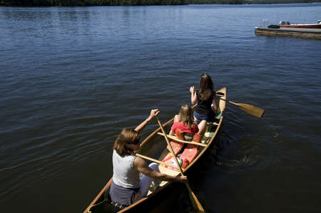 Family canoeing on lake, Lake of the Woods, Ontario, Canada 写真素材
