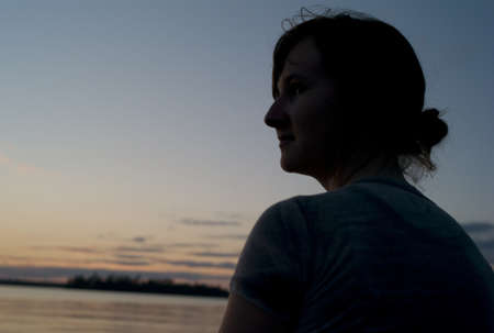 lakeshores: Woman enjoying sunset, Lake of the Woods, Ontario, Canada