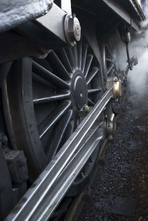 Close-up of steam engine train wheel photo
