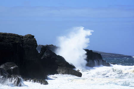 co action: The Burren, Co Clare, Ireland; Waves breaking against rocks