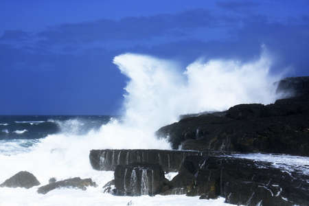 breaking: The Burren, Co Clare, Ireland; Waves breaking against the rocks Stock Photo