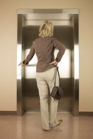 Woman waiting for an elevator Stock Photo - 7196086