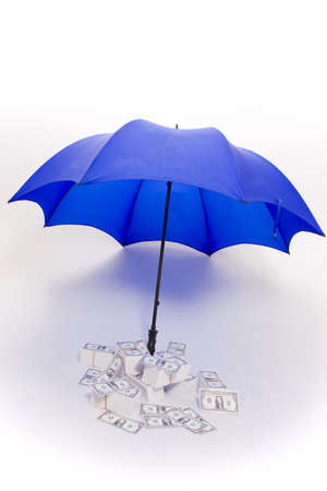 weather protection: Umbrella covering piles of money