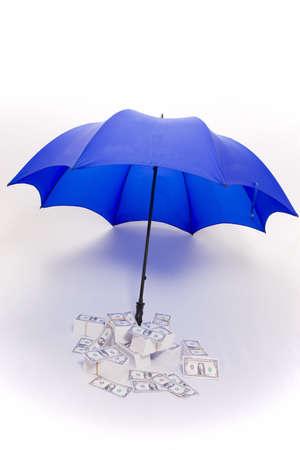 Umbrella covering piles of money
