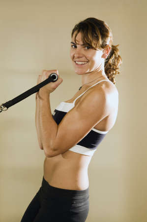 something athletic: Young woman training in gym   Stock Photo