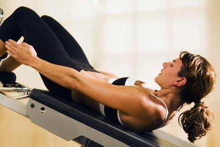 something athletic: Woman doing abdominal exercises   Stock Photo