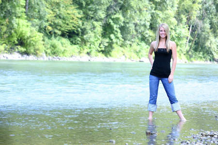 colleen: Teen girl standing in stream Stock Photo