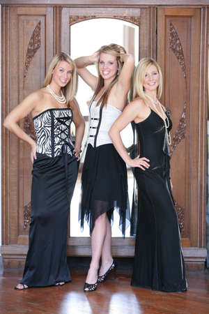 formal attire: Three teenage girls dressed in formal wear Stock Photo