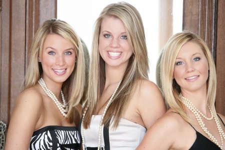 Three teenage girls in formal wear Stock Photo - 7198762