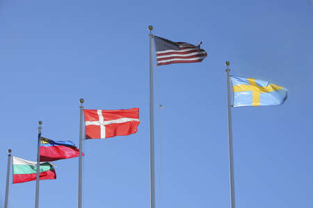 Flags of Bulgaria, Liechtenstein, Denmark, United States and Sweden; Flags flapping in the wind Фото со стока