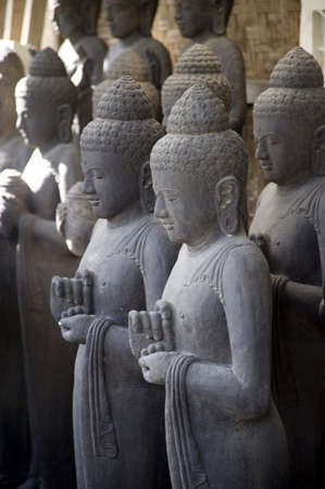 supplicating: Bali, Indonesia, Asia; Praying stone statues Stock Photo