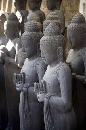 intercessory prayer: Bali, Indonesia, Asia; Praying stone statues Stock Photo