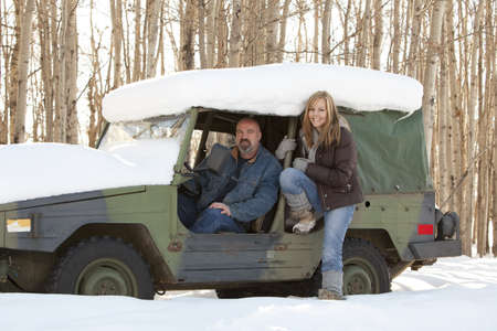 thirty something: Man and woman in a snow covered vehicle