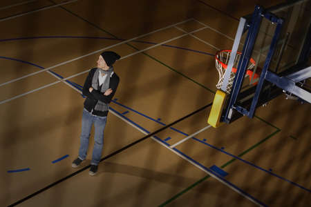 leah: Man standing in basketball court
