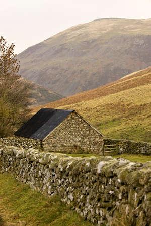 abodes: Northumberland, England; Stone house with stone fence Stock Photo