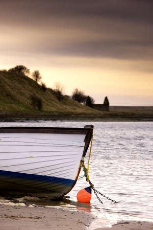 Boat on seashore, Alnmouth, Northumberland, England Stock Photo - 7192902