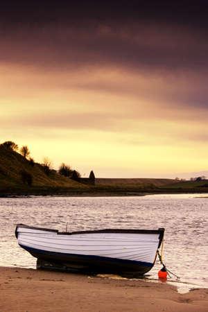 mornings: Boat on seashore, Alnmouth, Northumberland, England Stock Photo