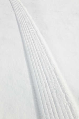 Tire tracks in snow Stock Photo - 7195085