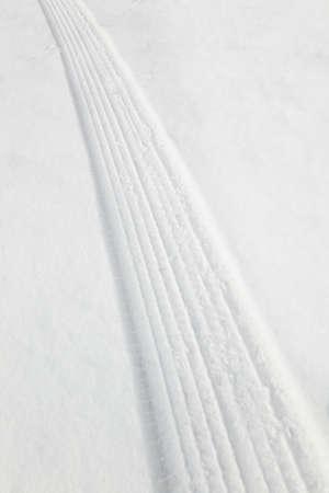 tire tracks: Tire tracks in snow Stock Photo