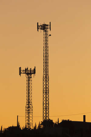 mornings: Silhouette of cell phone masts Stock Photo
