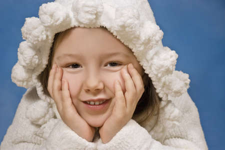 Portrait of a young girl in robe with hood photo