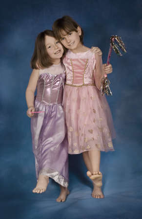preadolescent: Portrait of young girls in fancy dresses
