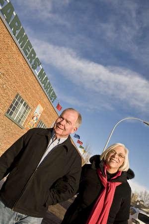 Senior couple outside farmer's market, Old Strathcona, Edmonton, Alberta, Canada Stock Photo - 7194487