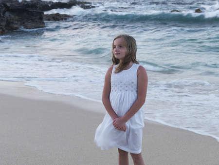 caucasian ancestry: Girl standing on the beach, Maui, Hawaii Stock Photo